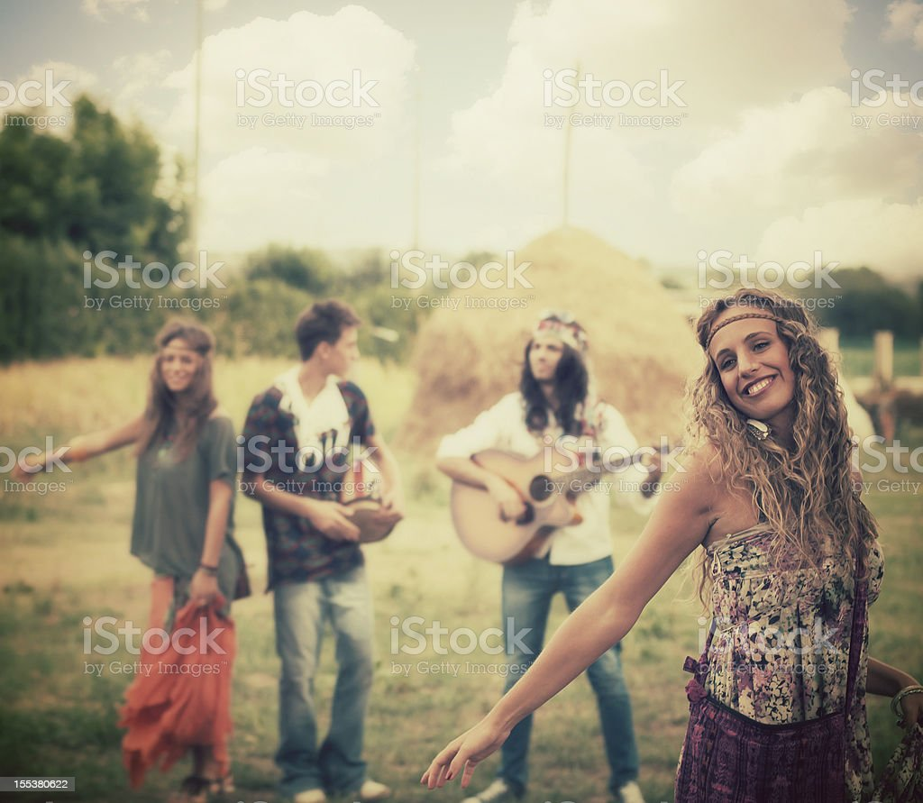 Hippie girl dancing with her friends royalty-free stock photo