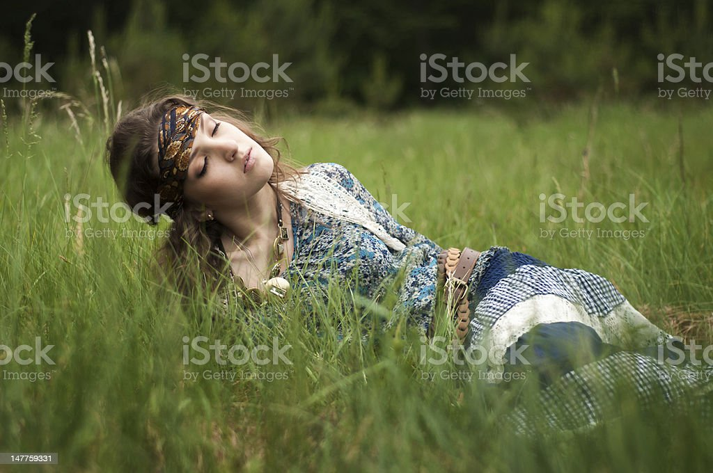 Hippie girl lies in the grass royalty-free stock photo
