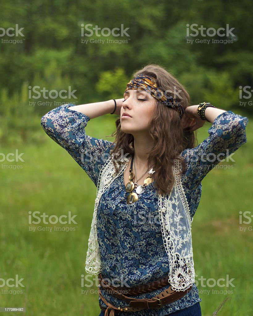 Hippie girl on the background of beautiful scenery royalty-free stock photo