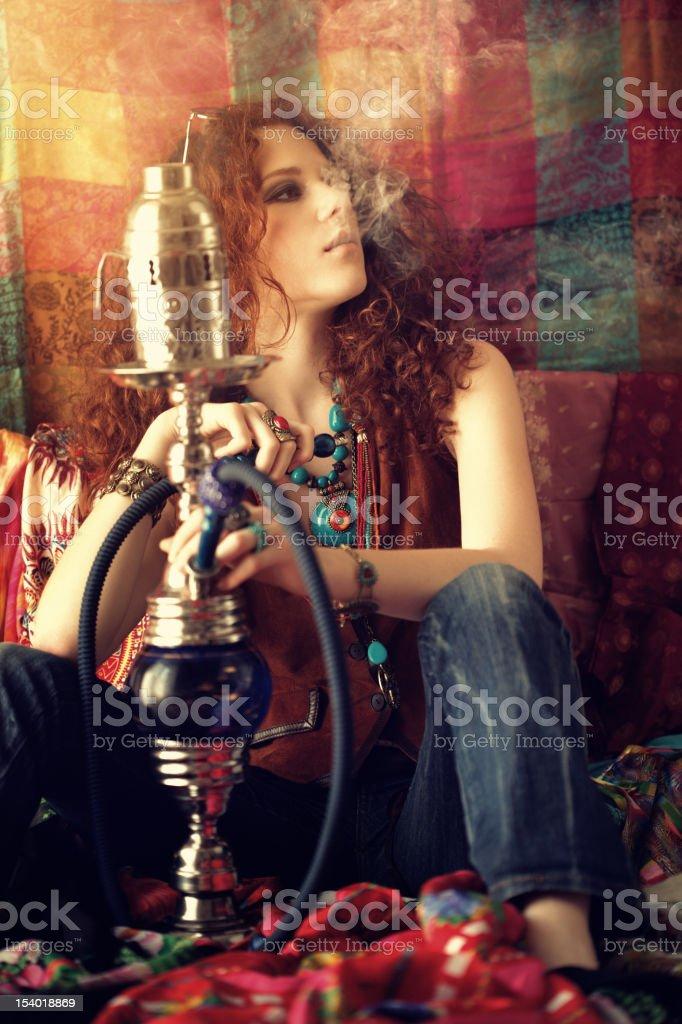 hippie girl smoking hookah stock photo