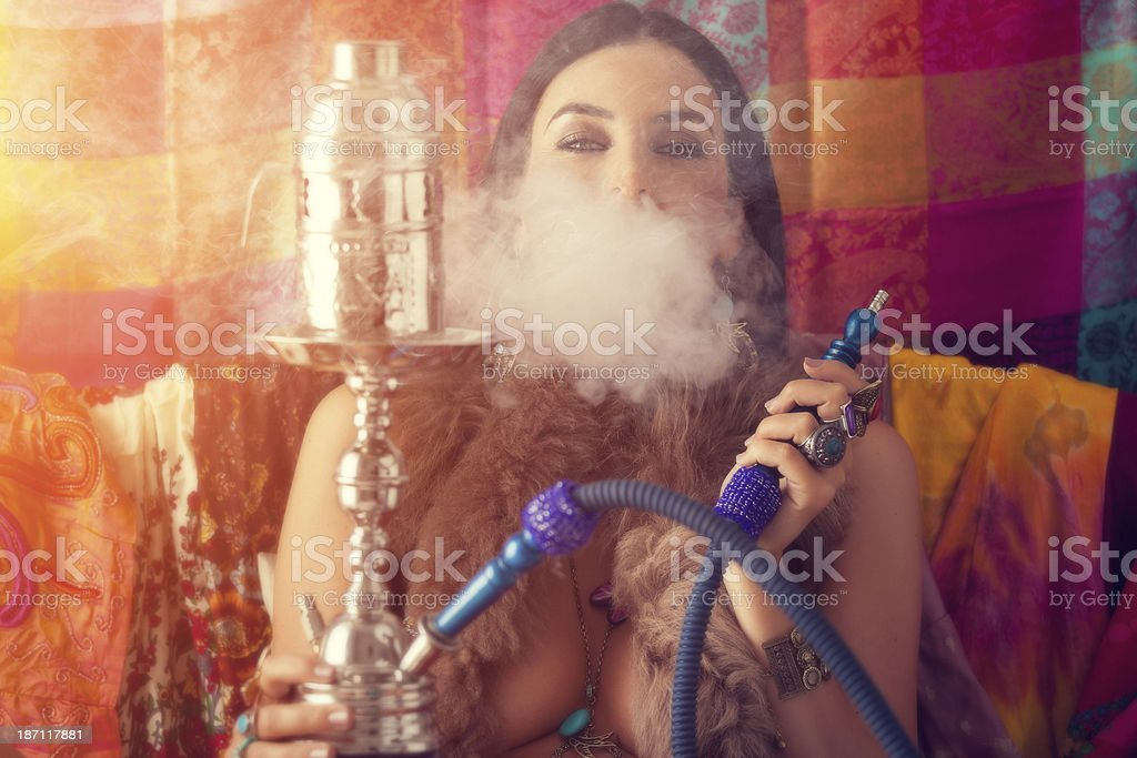 hippie girl smoking water pipe stock photo