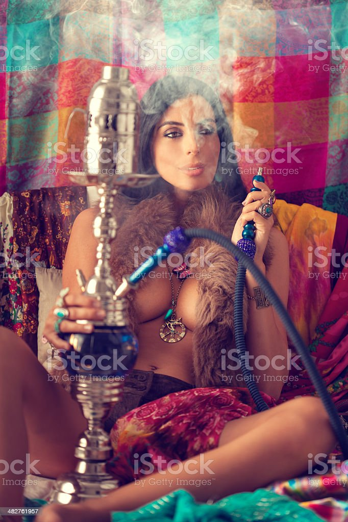 hippie girl smoking water pipe stock photo