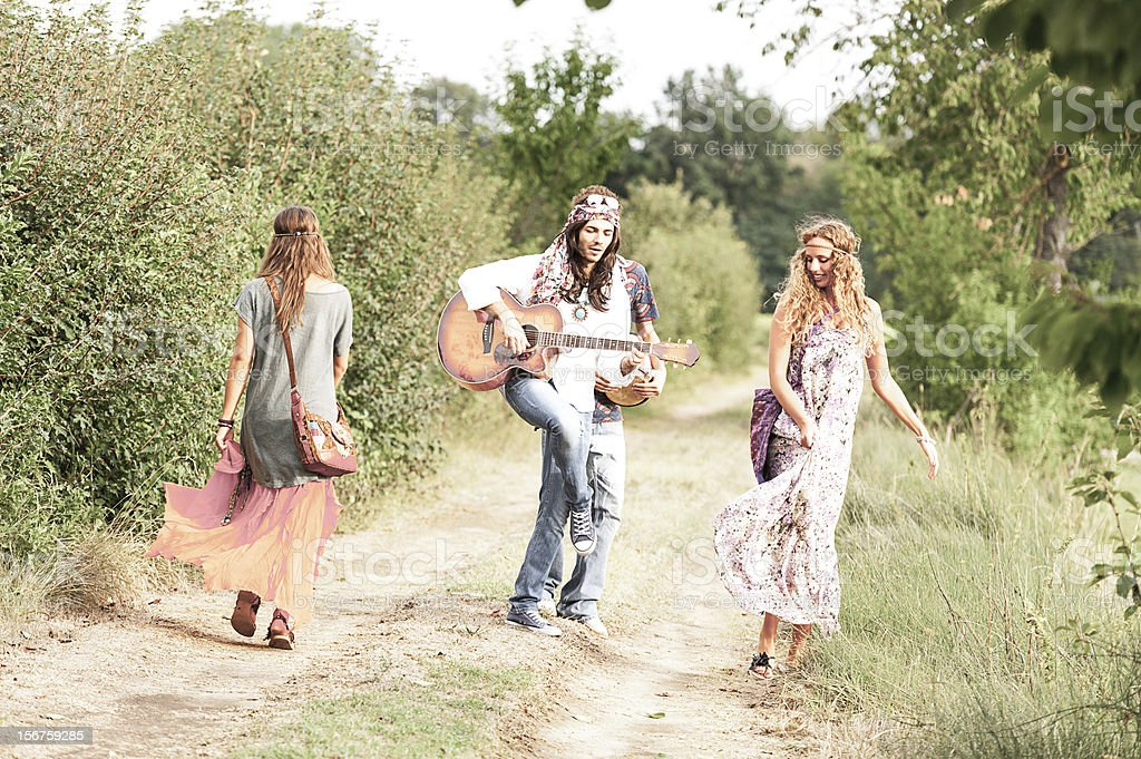 Hippie Group Dancing in the Countryside royalty-free stock photo