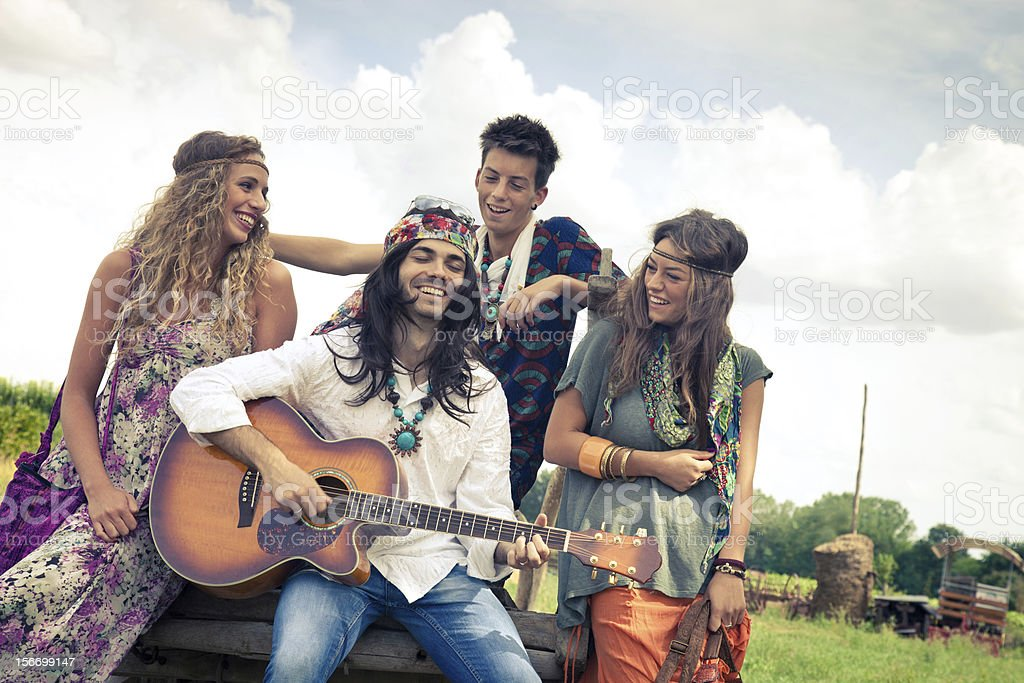 Hippie group play guitar together royalty-free stock photo