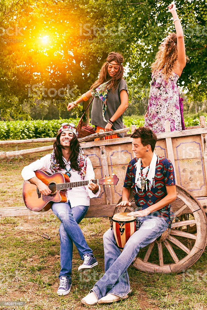 Hippie group singing and dancing on a cart royalty-free stock photo