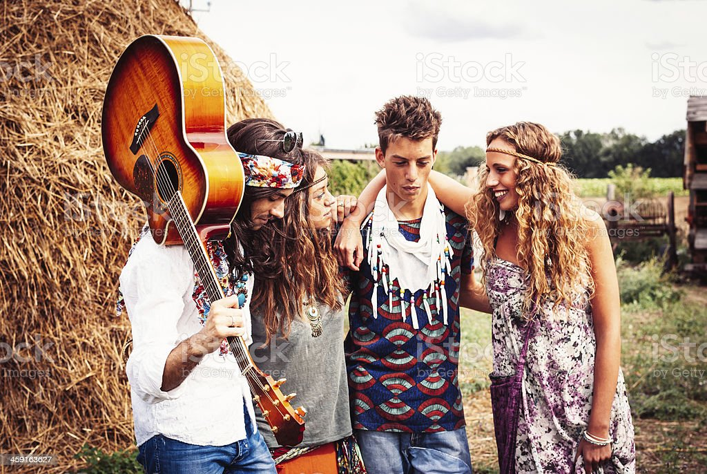 Hippie group smiling together stock photo