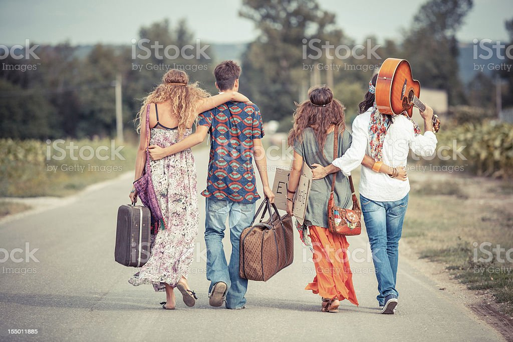 Hippie Group Walking on a Countryside Road stock photo