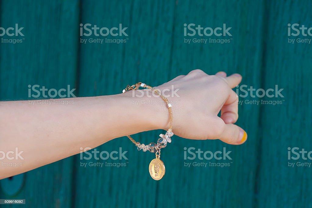 Hippie hand with a bracelet stock photo