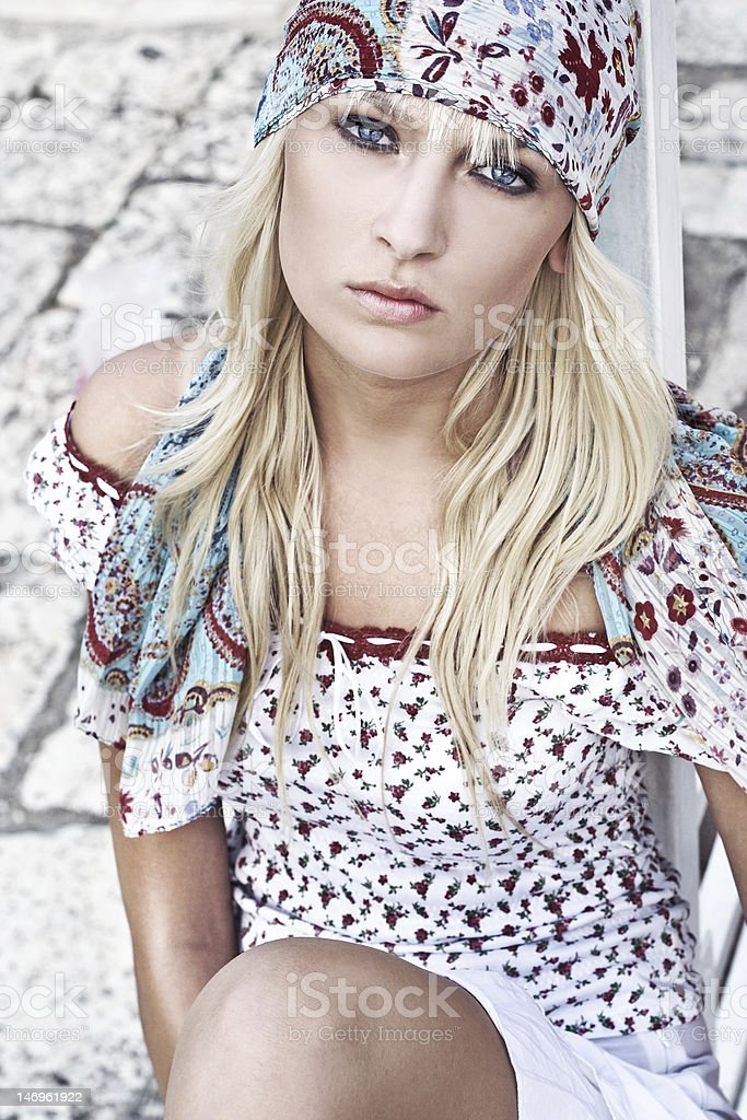 Hippie looking young blonde on a sunny day royalty-free stock photo