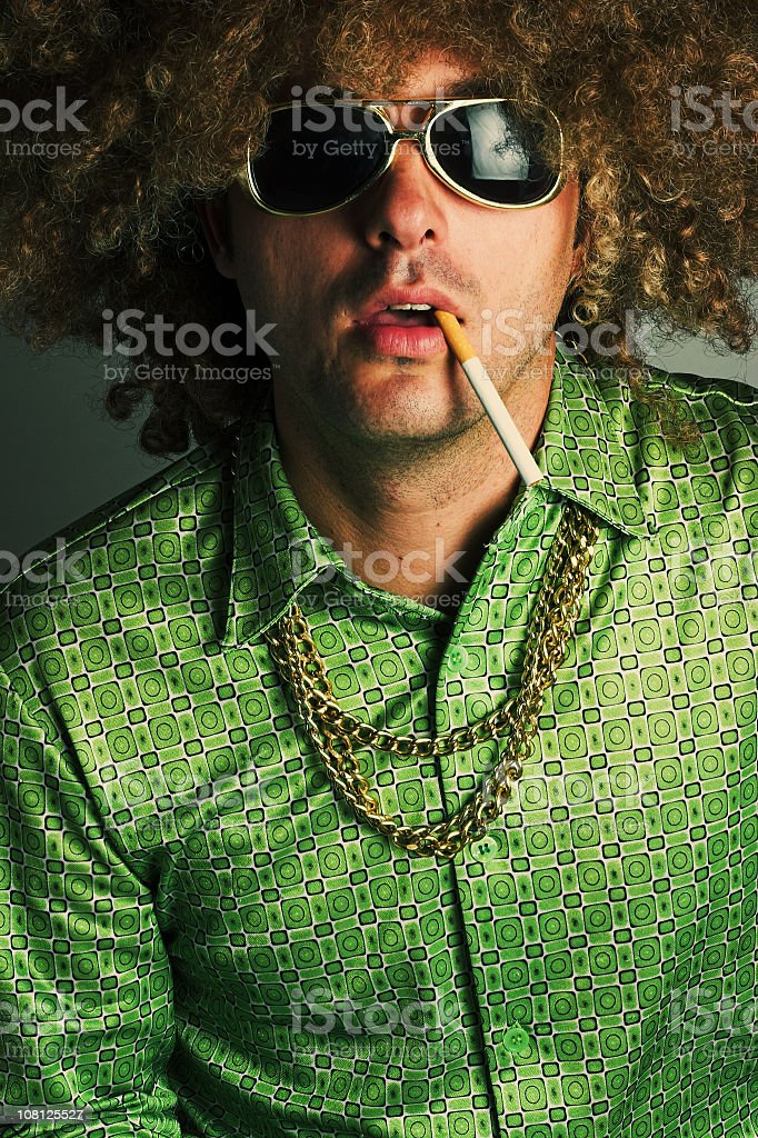 Hippie Man Smoking Cigarette stock photo