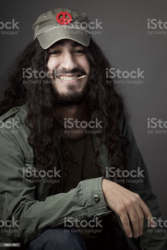 Hippie man with hat smoking biddie royalty-free stock photo
