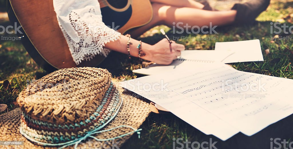 Hippie Musician Songwriter Writing Concept stock photo