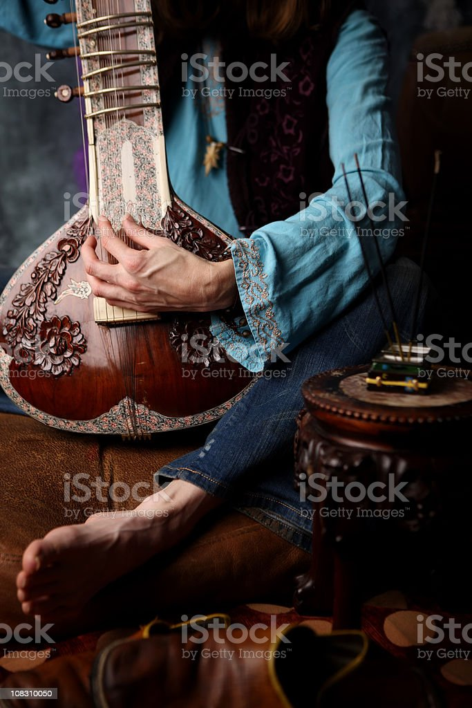Hippie playing sitar stock photo