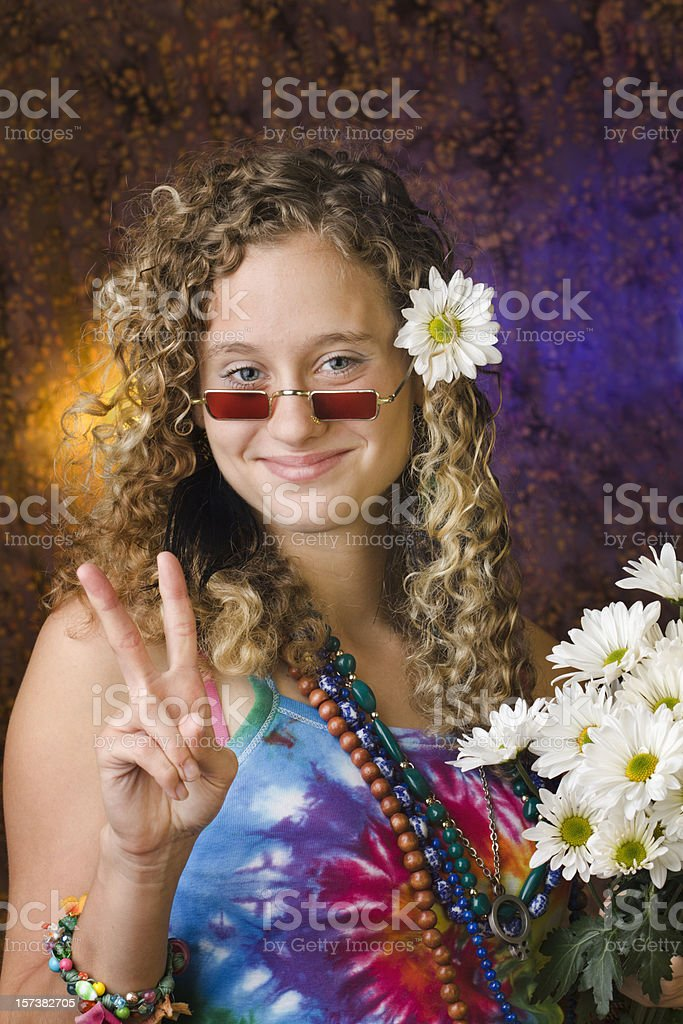 Hippie Teenage Girl Wearing 1960s Psychedelic Style, Flashing Peace Sign royalty-free stock photo