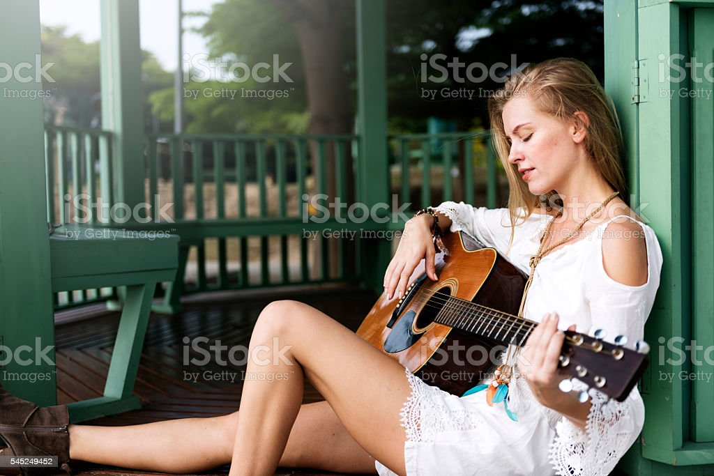 Hippie Woman Playing Music Concept stock photo