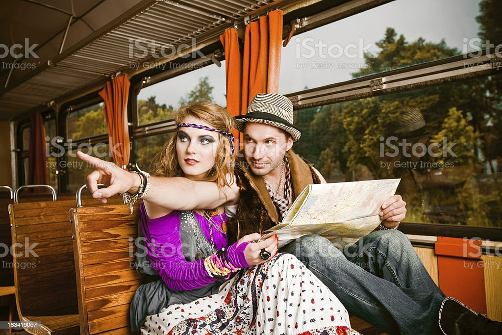 Hippie young couple in a train royalty-free stock photo