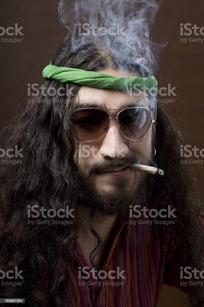 Hippie young man smoking royalty-free stock photo
