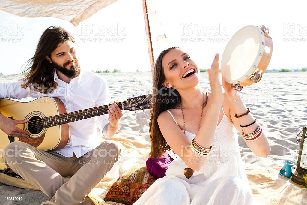 Hippipe couple playing music stock photo