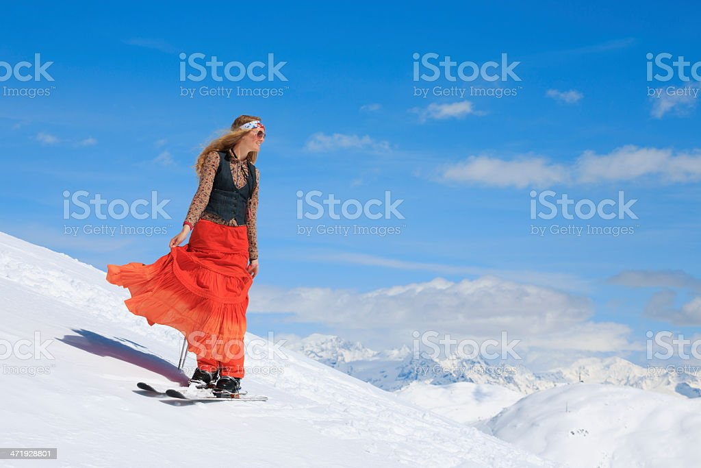 Hippy  Beautiful blonde young woman   Telemark snow skier    Ski vacation royalty-free stock photo