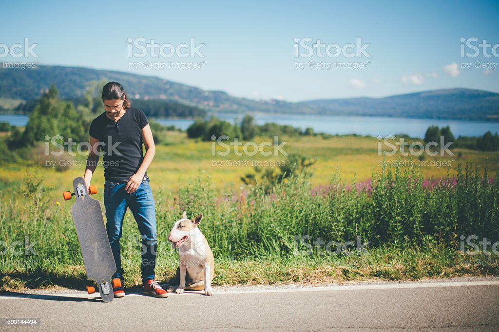 Hipster and his bull terrier stock photo