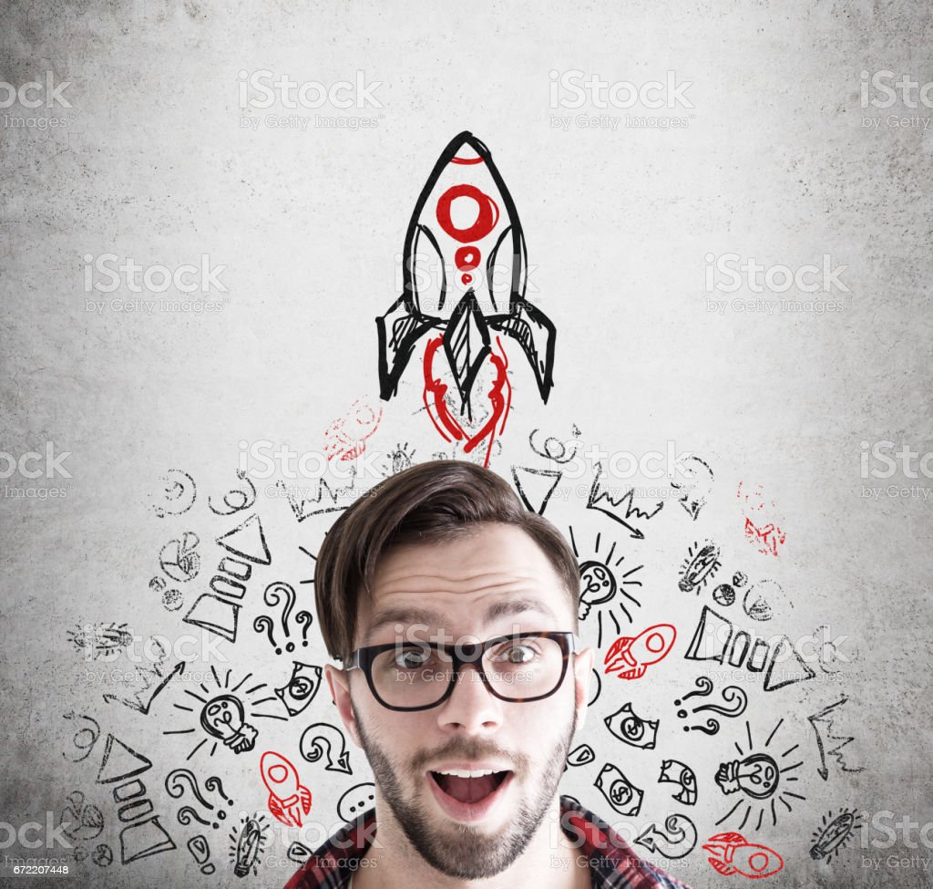 Hipster businessman and rocket on concrete stock photo