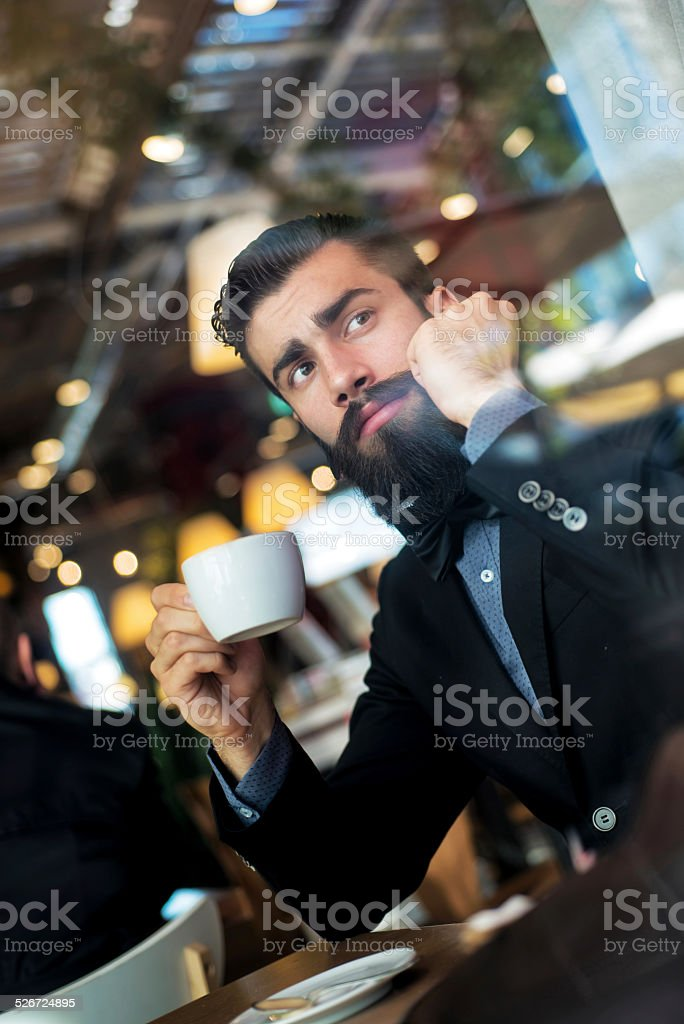 Hipster Businessman Drinking Cappuccino stock photo