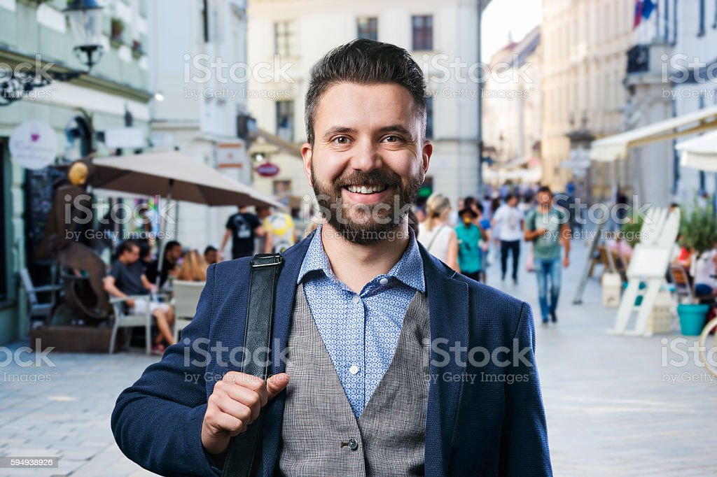 Hipster businessman in blue shirt in the city stock photo