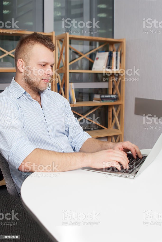 Hipster businessman working at his desk office stock photo