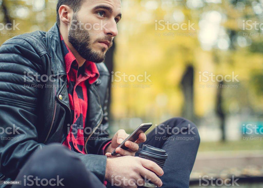 Hipster checking social media on coffee break stock photo