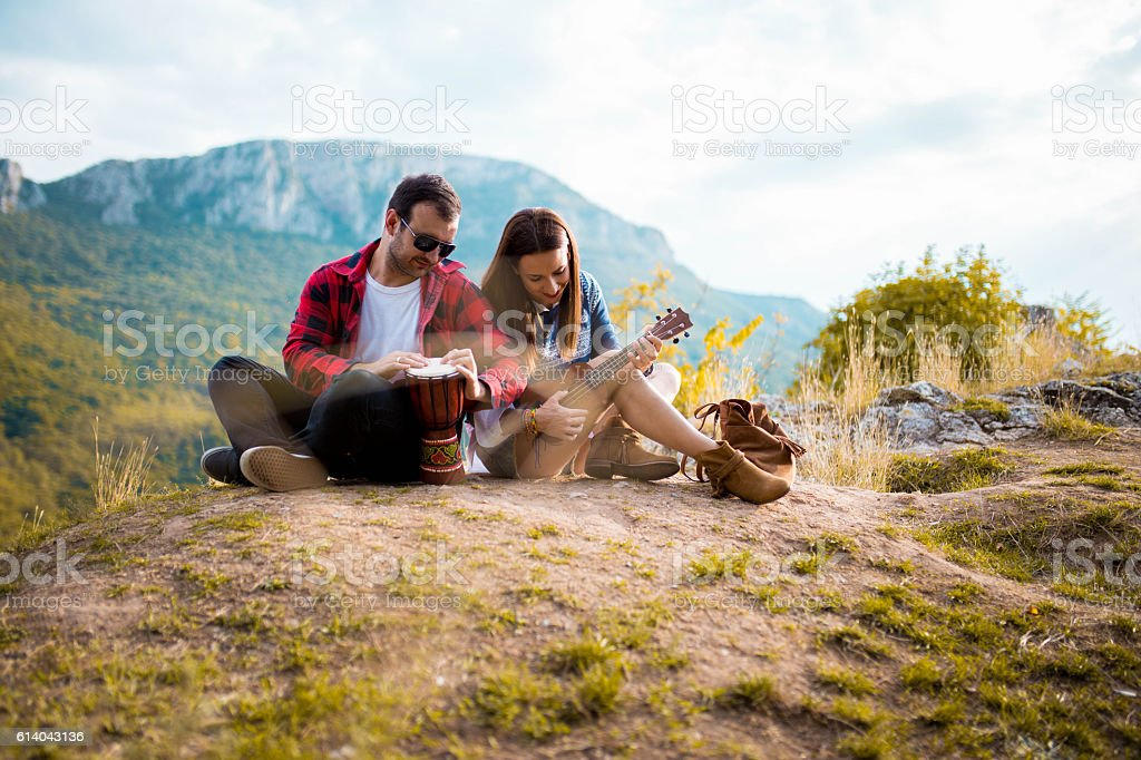 Hipster couple in the mountains stock photo
