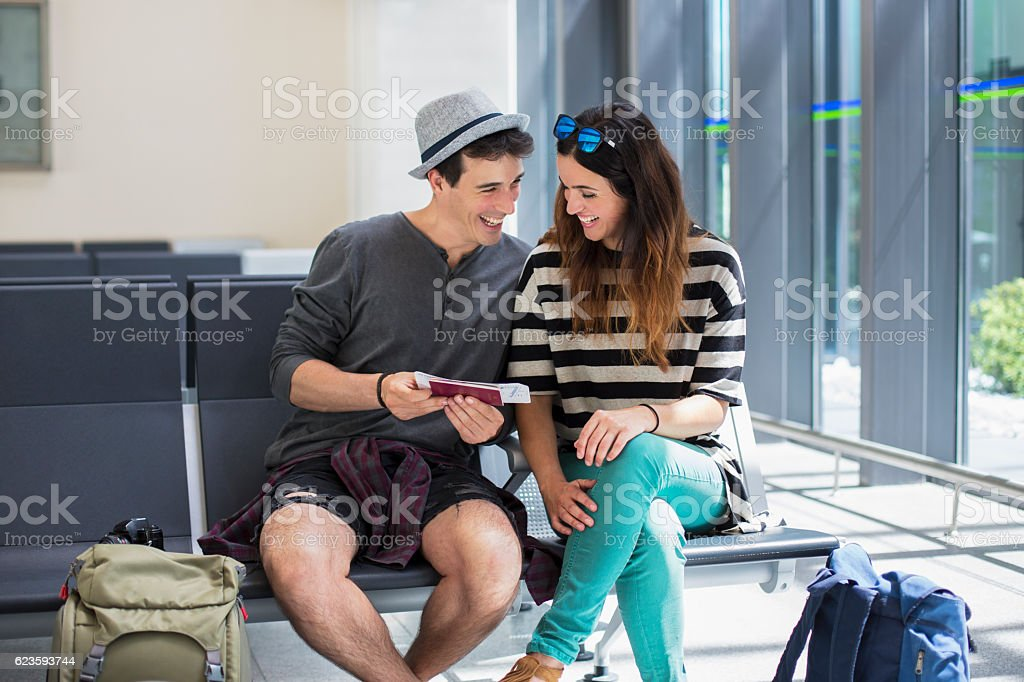 Hipster couple off on holiday stock photo