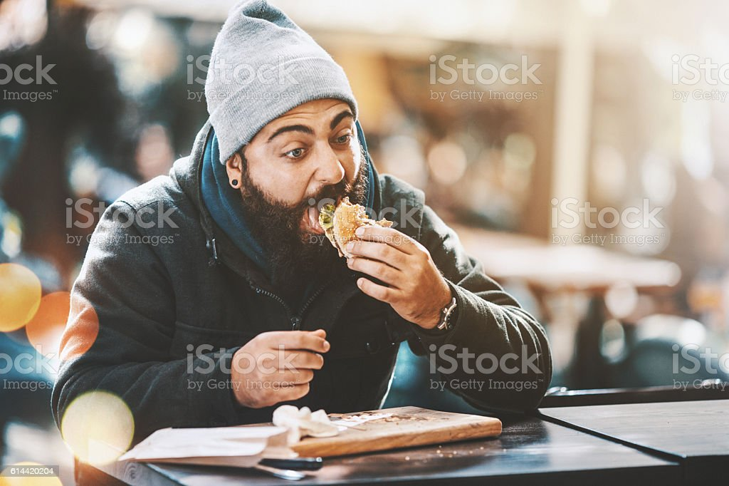 Hipster do eat as well. stock photo