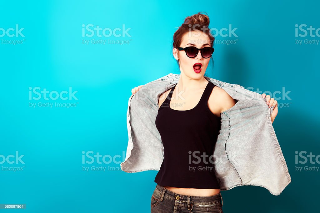 Hipster Fashion Girl on Turquoise Background stock photo