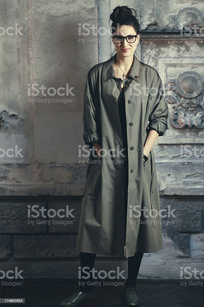 Hipster fashion portrait of a woman in trench coat stock photo