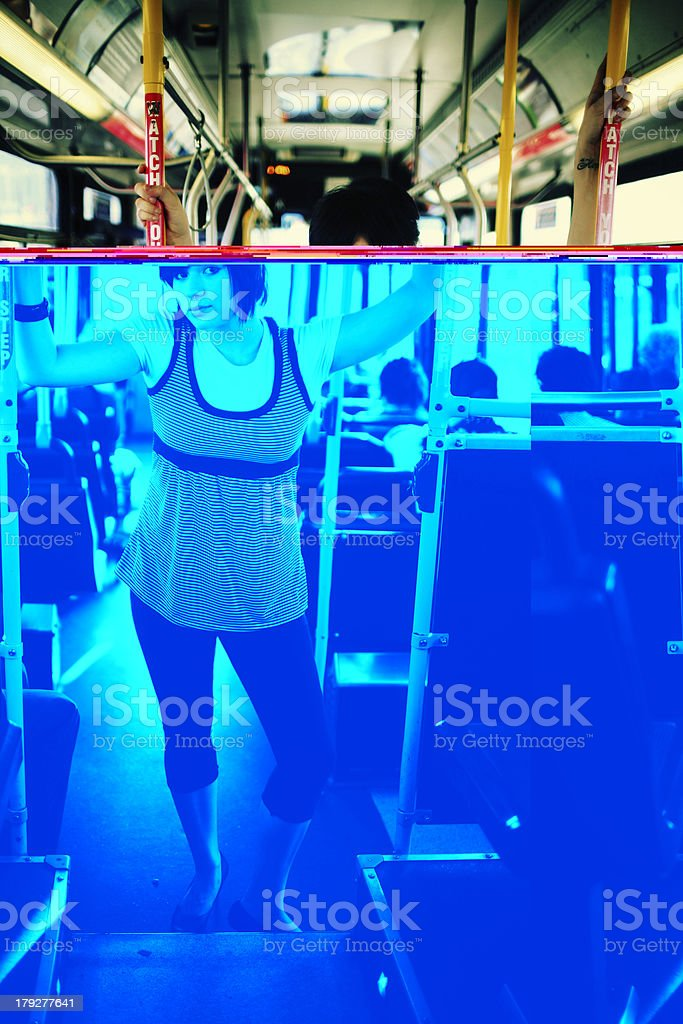 HIpster Female Holding onto Bus Rails royalty-free stock photo