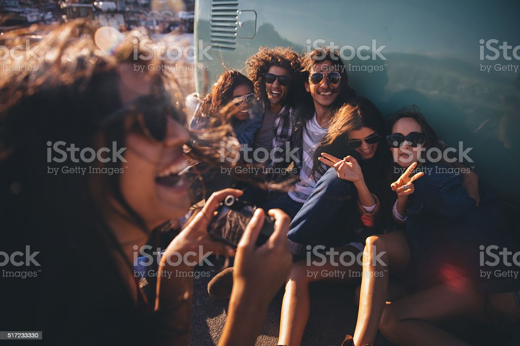 Hipster friends having fun with pictures on road trip stock photo