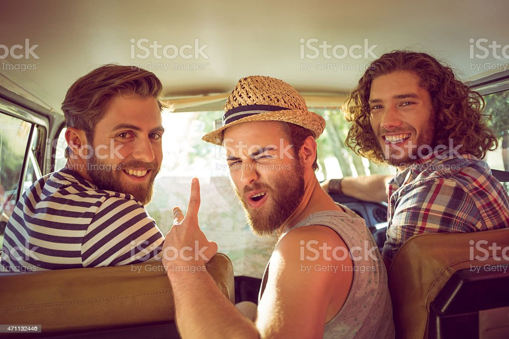 Hipster friends on road trip stock photo
