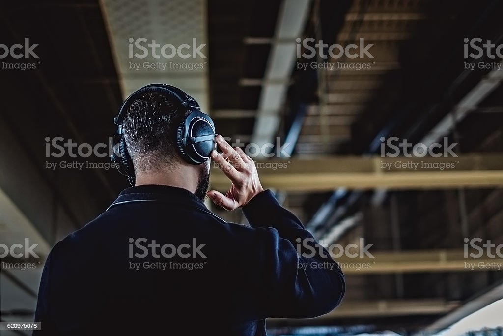 Hipster from the back listening music stock photo
