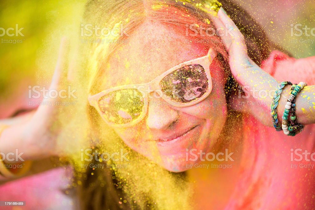 Hipster girl at Holi Festival with sunglasses royalty-free stock photo