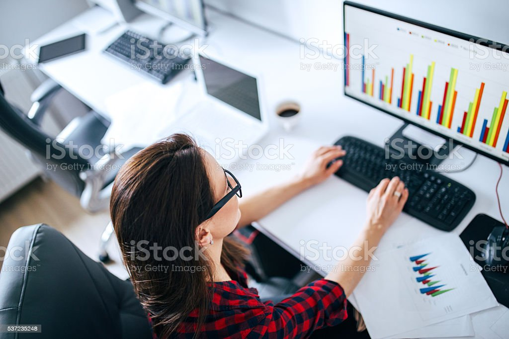 Hipster girl at the office stock photo