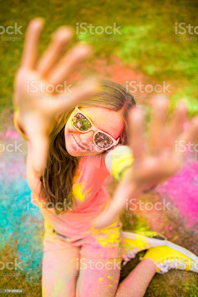 Hipster girl celebrating Holi Festival with colorful powder royalty-free stock photo