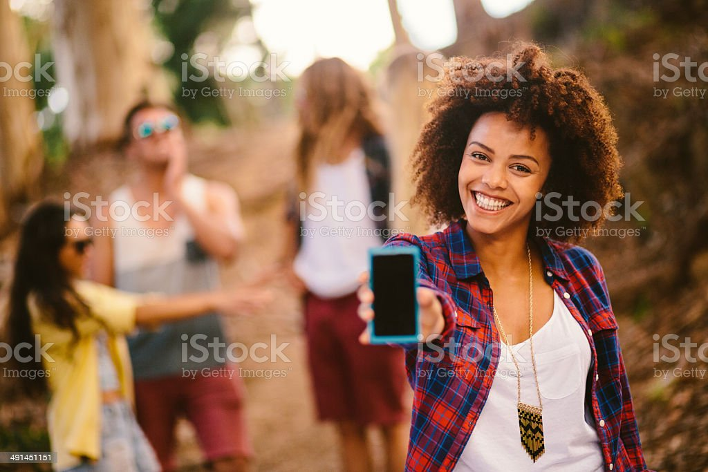 Hipster girl is holding a smartphone stock photo