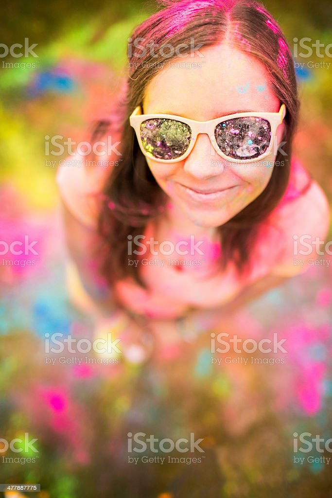 Hipster girl looking at camera Holi Festival with colorful powder royalty-free stock photo