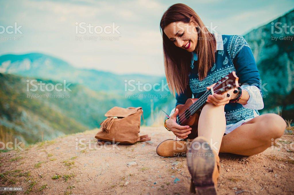 Hipster girl playing ukulele stock photo