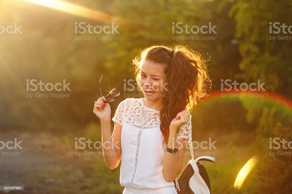 Hipster girl showing tongue and winks. stock photo