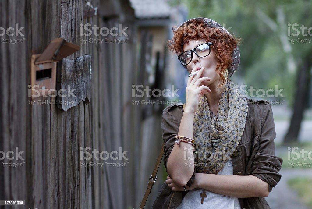 Hipster girl smoking cigarette royalty-free stock photo