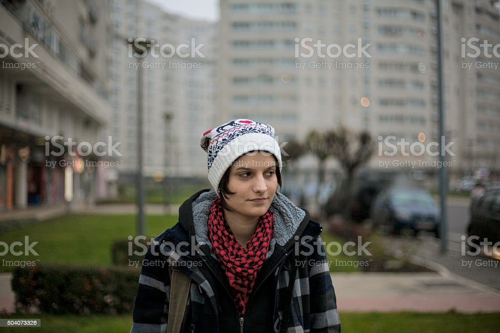 Hipster girl standing in the street at dusk royalty-free stock photo