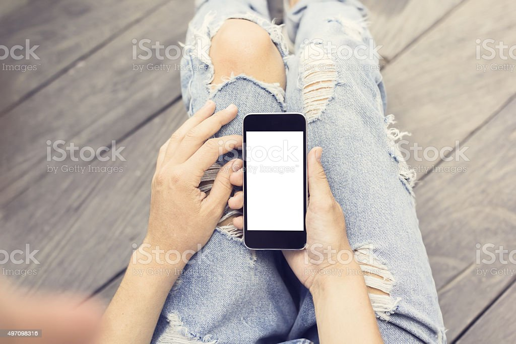 Hipster girl with blank cell phone, mock up stock photo