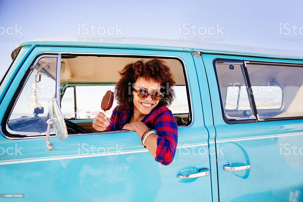Hipster girl with icecream in camper van stock photo