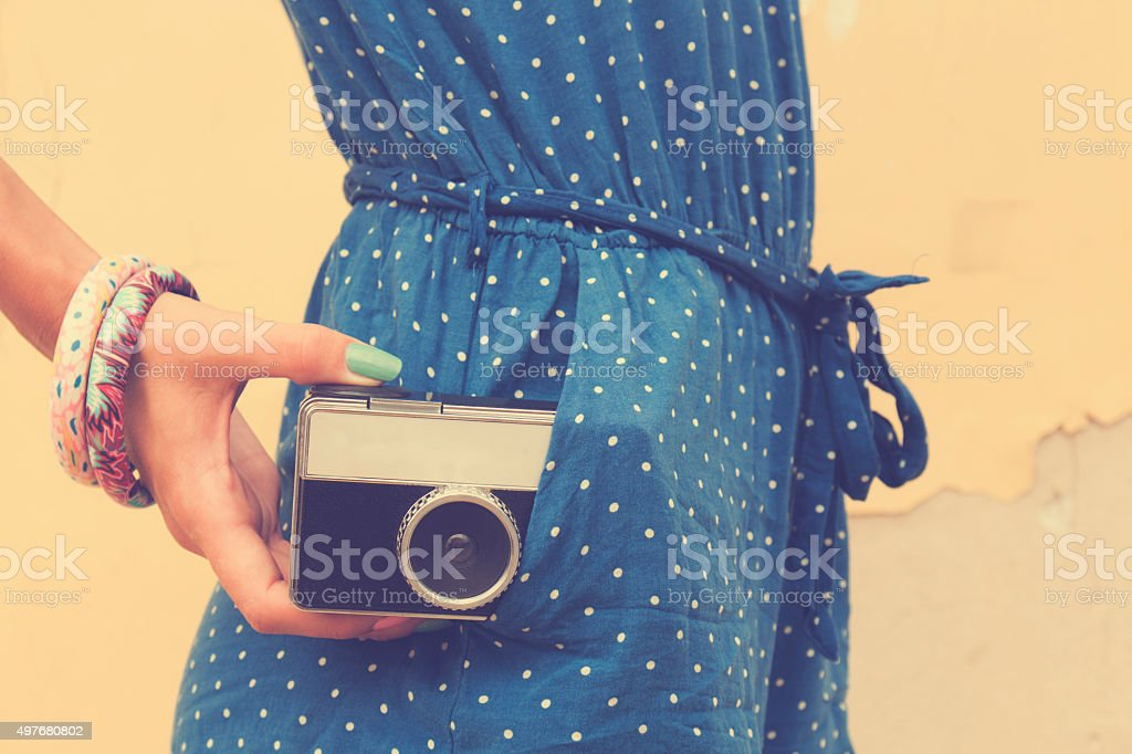 Hipster girl with old camera. stock photo